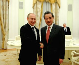 RUSSIA MOSCOW PUTIN CHINESE FM MEETING