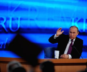 Vladimir Putin attends the annual news conference in Moscow