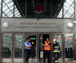 Rescuers and repair personnel work outside the Slavyanski Bulvar subway station in Moscow, capital of Russia