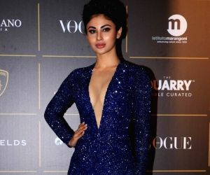 Mouni Roy goes poetic in her oomph filled satin black pose : 'My lips have felt love'