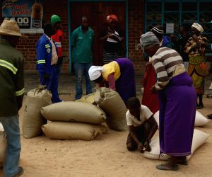 MT DARWIN, Oct. 13, 2019 - Villagers collect their monthly subsidized maize from the government in Mt. Darwin, Zimbabwe, Oct. 11, 2019. Zimbabwe is facing severe food shortages due to a combination ...
