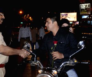 Policemen greet people with roses on new year's eve