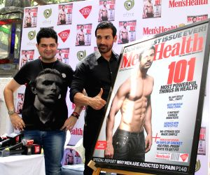 John Abraham unveils Men's Health magazine's latest cover