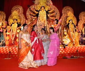 Mumbai: Actresses Kajol and Tanishaa Mukerji with thier mother Tanuja at a Durga Puja pandal in Juhu Mumbai on Oct 4, 2019. (Photo: IANS)