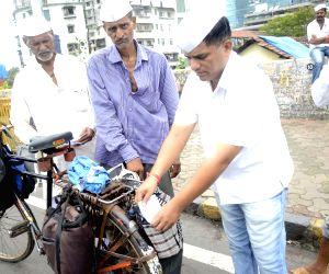 Mumbai Dabbawalas campaign for Malin landslide victims