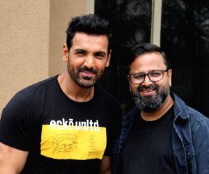 "Mumbai: Director Nikkhil Advani and actor John Abraham during the promotions of their upcoming film ""Batla House"" in Mumbai on Aug 6, 2019. (Photo: IANS)"