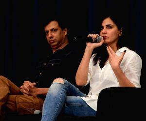 "Mumbai:Film Director Madhur Bhandarkar and Actress Kirti Kulhari during the screening of film ""Indu Sarkar"" in Mumbai on Sept 6, 2017. (Photo: IANS)"