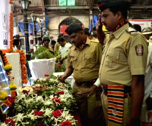 People pay homage to the victims of  26/11 attacks -CST