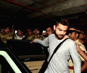 Virat Kohli, Anushka Sharma arrive from ICC WC15