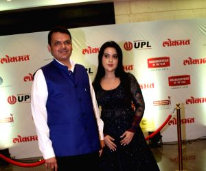 "Lokmat Maharastrian Of The Year award"" - Devendra Fadnavis and Amruta Fadnavis"