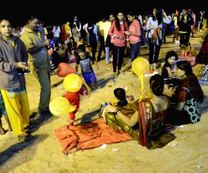 People celebrate new year's eve at Juhu
