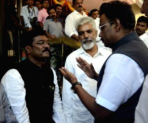 Shivsena legislator Pratap Sarnaik meets BJP legislator Vinod Tavde at Maharashtra Assembly
