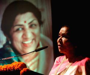 :Mumbai: Singer Asha Bhosle addresses at the launch of her sister Meena Mangeshkar-Khadikar's book 'Mothi Tichi Savli', based on the life of Lata Mangeshkar; in Mumbai on Sept 28, ...