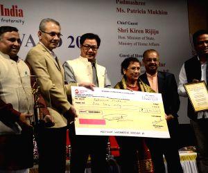 Kiren Rijiju confers ONE India Award 2014 to Patricia Mukhim