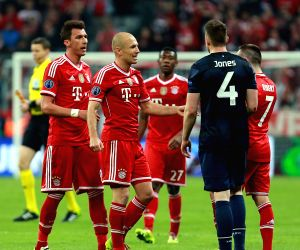 Bayern Munich's players celebrates after the UEFA Champions League quarter-final second leg football match against Manchester United