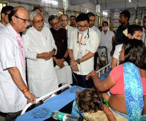 Muzaffarpur: Bihar Chief Minister Nitish Kumar accompanied by Deputy Chief Minister Sushil Kumar Modi visits children with encephalitis symptoms at a hospital in Muzaffarpur, Bihar, on June 18, 2019. (Photo: IANS)