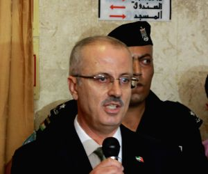 Rami Hamdallah speaks during his visit at Courts Complex