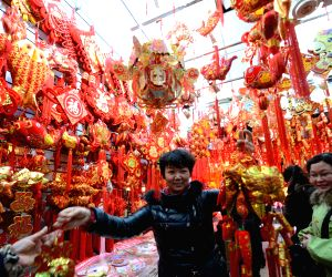 A consumer selects New Year decorations at a shopping mall in Nanchang