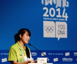 Volunteer representative Zhao Zishan speaks during the press conference