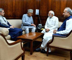 National Conference leaders Farooq Abdullah, Omar Abdullah and Hasnain Masoodi meet Prime Minister Narendra Modi, in New Delhi on Aug 1, 2019.