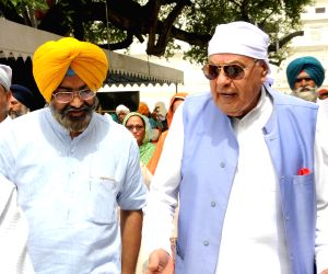 NC president Farooq Abdullah at Golden Temple