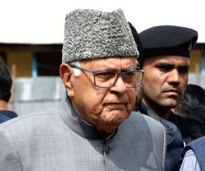 National Conference President Farooq Abdullah, who appeared set to win the 2019 Lok Sabha election from Srinagar, comes out of an election counting center during the counting of votes cast ...