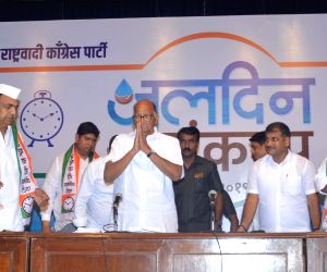 Nationalist Congress Party (NCP) chief Sharad Pawar, his nephew Ajit Pawar and Maharashtra party President Jayant Patil during the party's 20th anniversary celebration in Mumbai on June 10, ...