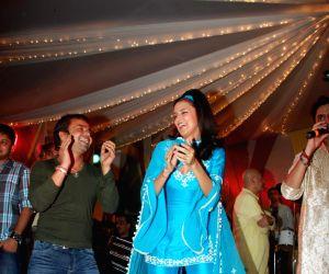 Neha Dhupia, Rajpal promote Action Replay at Juhu Jagruti Navratri at Juhu.