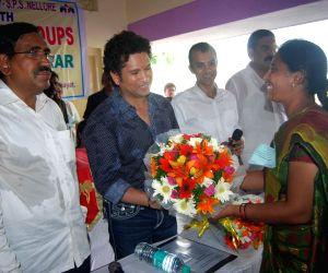 Sachin Tendulkar adopts Andhra village  )