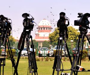 :New Delhi: Active presence of media seen outside the Supreme Court as the apex court hears several cases related to the CBI row, Sabarimala temple issue and the Rafale deal, as it re-opened after ...