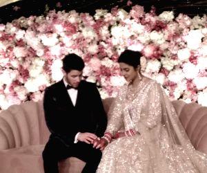 New Delhi: Actress Priyanka Chopra and her husband American singer Nick Jonas at their wedding reception in New Delhi on Dec 4, 2018. (Photo: IANS)