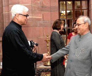 Writer In Residence Programme- Amitav Ghosh calls on President Mukherjee