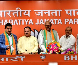 New Delhi: BJP Working President J.P. Nadda with TDP MPs Y. S. Chowdary, T. G. Venkatesh and C.M. Ramesh who joined the BJP, at the party's headquarters in New Delhi on June 20, 2019. (Photo: IANS)