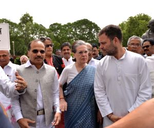 New Delhi: Congress leaders Rahul Gandhi,Sonia Gandhi,Shashi Tharoor and others stage a demonstration against Karnataka and Goa crisis,outside Parliament House in New Delhi, on July 11, 2019. (Photo: IANS)