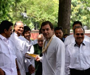 New Delhi: Congress President Rahul Gandhi with party leaders K. C. Venugopal, Motilal Vora and Rajasthan Chief Minister Ashok Gehlot during his birthday celebrations at the party's headquarters, in New Delhi on June 19, 2019. (Photo: IANS)