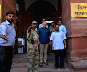 New Delhi: Delhi Chief Minister Arvind Kejriwal and Deputy Chief Minister Manish Sisodia come out after meeting Union Finance and Corporate Affairs Minister Nirmala Sitharaman, in New Delhi on June 27, 2019. (Photo: IANS)