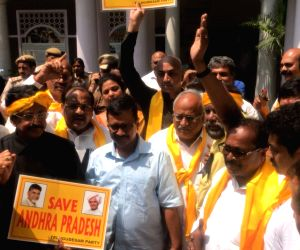 : New Delhi: Delhi Chief Minister Arvind Kejriwal meets Telugu Desam Party (TDP) MPs who were detained by police while marching towards Prime Minister Narendra Modi's residence to demand ...