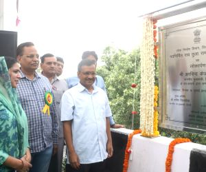 New Delhi: Delhi Chief Minister Arvind Kejriwal, Public Works Department Minister Satyendra Kumar Jain and AAP MLA Pramila Tokas unveil the plaque to inaugurate the newly constructed Rao Tula Ram (RTR) Flyover at Outer Ring Road near Munirka in New D