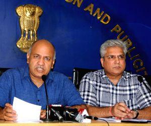 New Delhi: Delhi Deputy Chief Minister Manish Sisodia accompanied by Transport Minister Kailash Gahlot, addresses a press conference at the Delhi Secretariat, on July 11, 2019. (Photo: IANS)