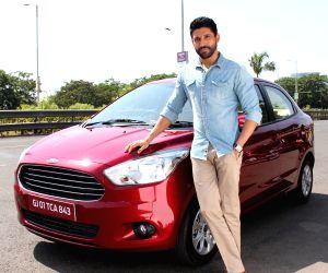 Farhan Akhtar poses with Ford Figo Aspire