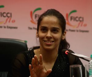 :New Delhi: Indian badminton player Saina Nehwal addresses during a felecitation programme organised by FICCI in New Delhi on May 5, 20128. .