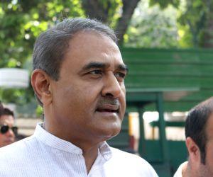 New Delhi: NCP leader Praful Patel talks to press outside the residence of former prime minister Manmohan Singh in New Delhi, on March 17, 2015. (Photo: Sunil Majumdar/IANS)