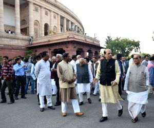 Opposition leaders march against land bill