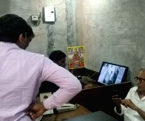 New Delhi: Police check CCTV footage at Gujarati Samaj Bhavan after Prime Minister Narendra Modi's relative whose purse was snatched in Civil Lines of New Delhi on Oct 12, 2019. (Photo: IANS)
