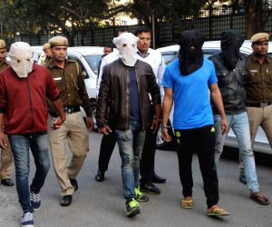 New Delhi: Police present before press four persons - Rohit Choudhary, 29, a resident of Aaya Nagar; Ravi, 29, a resident of Karol Bagh; and Anil Kumar and Rajesh Kumar, both 30-year-old and residents of Dakshinpuri - wanted in several criminal cases