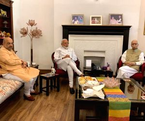New Delhi: Prime Minister Narendra Modi and BJP chief Amit Shah meet party veteran L.K. Adavni at his residence in New Delhi on May 24, 2019. The BJP on Thursday recorded a stunning and historic victory by winning 299 seats while it was leading on fo