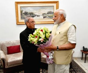 New Delhi: Prime Minister Narendra Modi meets Former President Pranab Mukherjee, in New Delhi on May 28, 2019. (Photo: Twitter/@narendramodi)