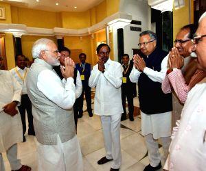:New Delhi: Prime Minister Narendra Modi with Bihar Chief Minister Nitish Kumar, Telangana Chief Minister K Chandrasekhar Rao, Chhattisgarh Chief Minister Raman Singh, Haryana Chief Minister ...