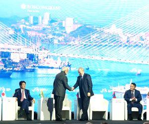 New Delhi: Russian President Vladimir Putin greets Prime Minister Narendra Modi at the Eastern Economic Forum (EEF) 2019 in Vladivostok, Russia on Sep 5, 2019. Also seen Japanese Prime Minister Shinzo Abe, Mongolian President Khaltmaagiin Battulga an
