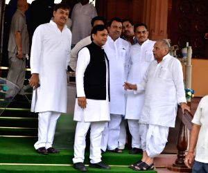 New Delhi: Samajwadi Party MPs Mulayam Singh Yadav and Akhilesh Yadav at Parliament in New Delhi on June 17, 2019. (Photo: IANS)